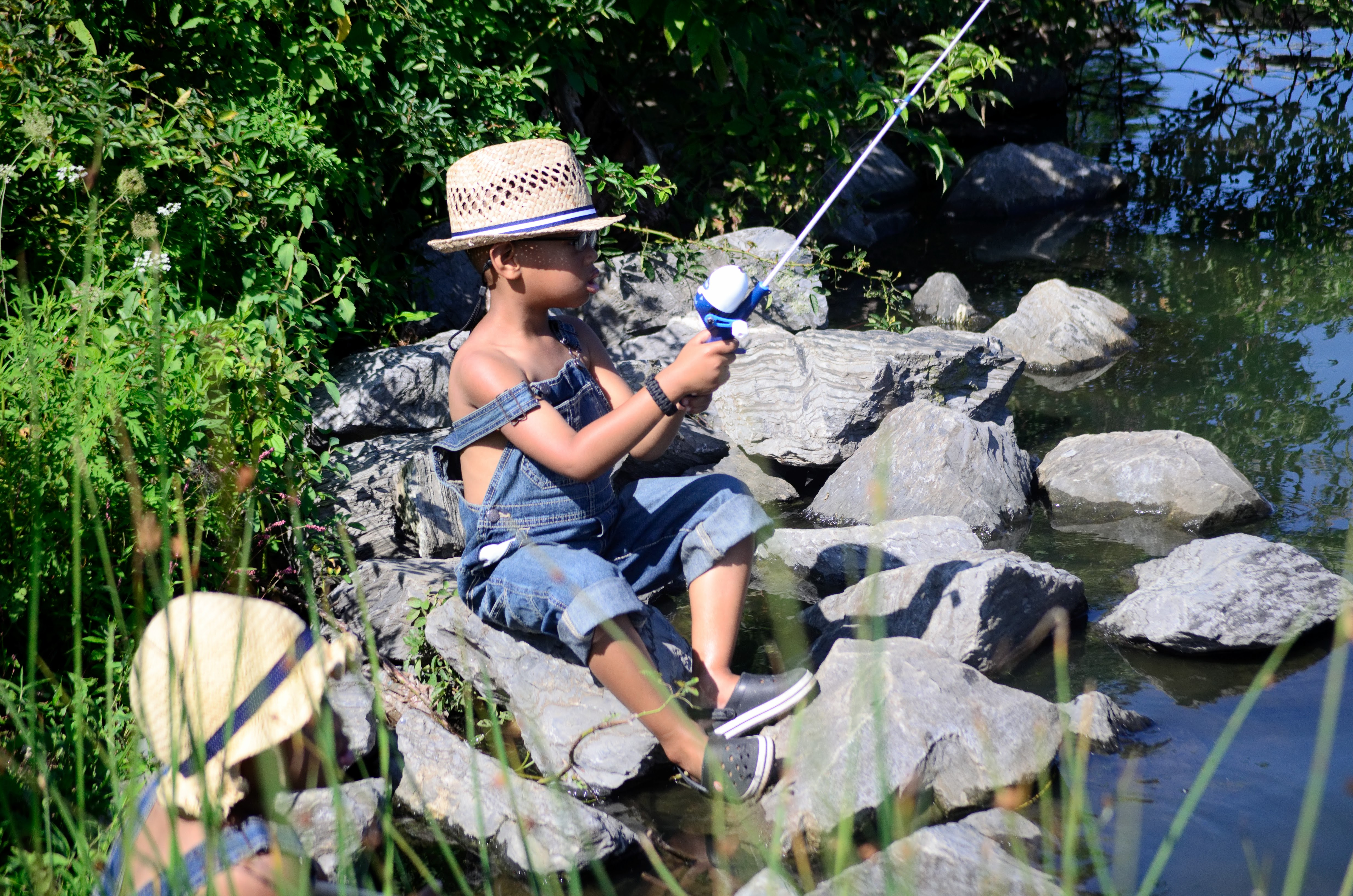 Fishing on the rocks at Lake Centennial in Ellicott City